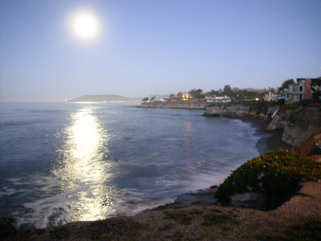 Full moon over Avila Beach California competes with sunrise